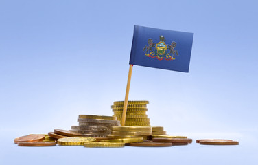 Flag of Pennsylvania in a stack of coins.(series)