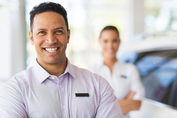 car salesman standing in front of colleague