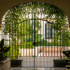House patio with iron gate in Seville