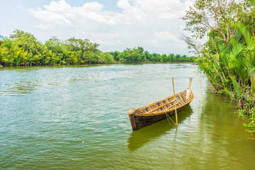 The traditional Thai wooden boat in natural Takua Pa river