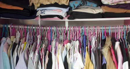 Clothes hanging in the closet