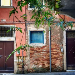 a blue window in Venice
