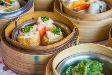 Small steamer baskets of Dim Sum in restaurant