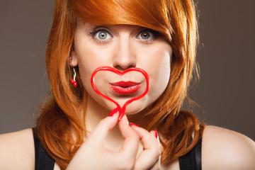 Girl holding valentine red heart love symbol. Valentines day.