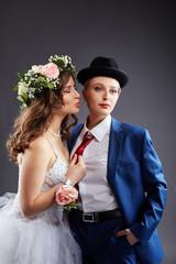 Lesbian married couple posing in studio