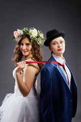 Beautiful lesbian couple in wedding outfits