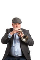 A man playing a vintage silver cornet, trumpet