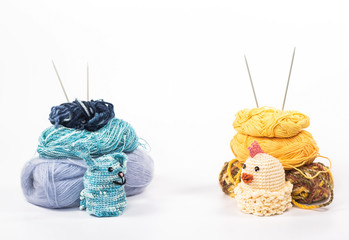 Knitted toys on background wooden yarn