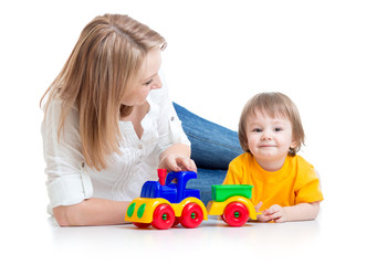 mom and kid boy playing block toys