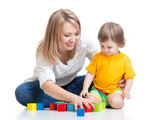 mother and baby play with building blocks toy isolated on white