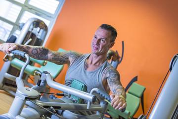man making seated rowing - workout routine .