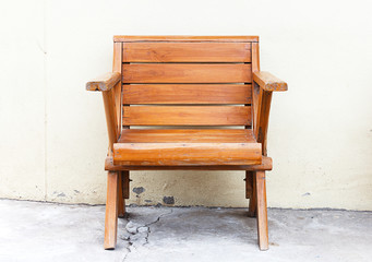 wooden chair cement wall
