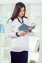 Portrait of a young woman with book