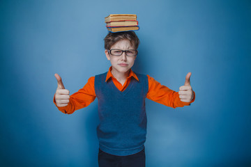 European-looking boy of ten years  in glasses with  books on her