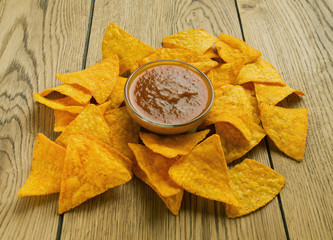 tortilla chips and tomato dip in a bowl