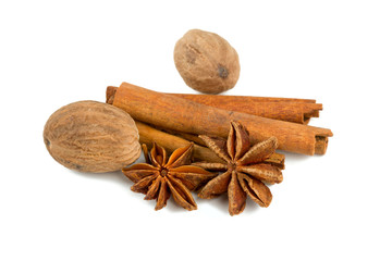 nutmeg, cinnamon and star anise isolated on white