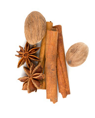 nutmeg, cinnamon and star anise isolated on white