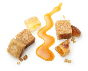 Brown cane sugar cubes and caramel