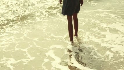 Lady walking at the beach
