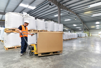 Workers in the warehouse scans the goods