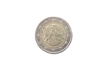 Commemorative 2 euro coin of Greece minted in 2010 over white
