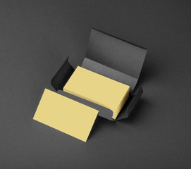 Beige business cards in the gray box.