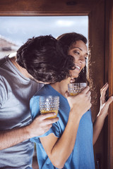 Romantic young couple looking at window