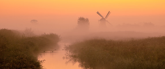 Dutch landscape with historic windmill
