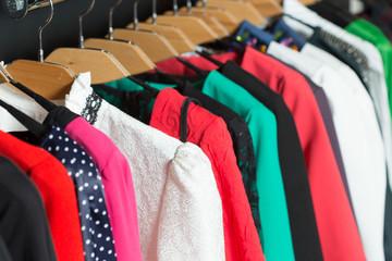 women's dresses on hangers in a retail shop