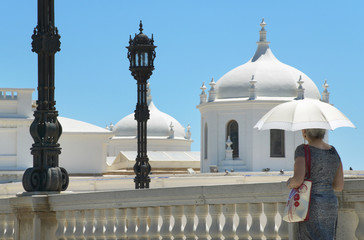 Woman with umbrella wlaking under the sun. Cadiz, Spain