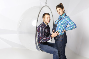 beautiful young couple, husband and wife in the studio