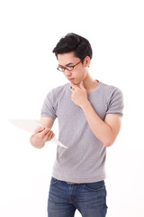 thinking genius nerd man looking, auditing at document with hand