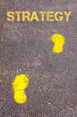 Yellow footsteps on sidewalk towards Strategy message