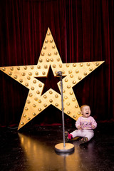 little girl crying in the background stars and microphone