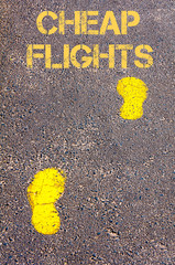 Yellow footsteps on sidewalk towards Cheap Flights message