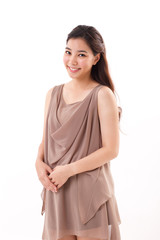 happy, positive asian woman in brown dress, white isolated backg