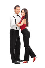 Young couple dancing with each other