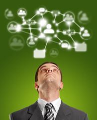 Businessman Looking Upwards in Social Network