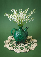 Still life with lily of the valley bunch
