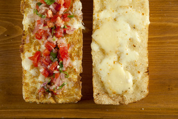 Toasted open faced salsa and egg sandwich with melted mozzarella