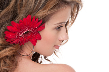 Close-up of beautiful girl with red aster flower