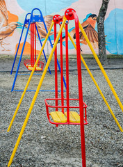 Colorful swing at the playground