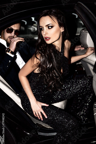 Sexy couple in the car. Hollywood stars. - 79148242