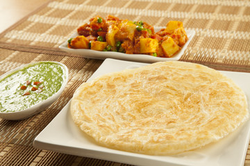Paratha with green chutney and mixed aloo bhaaji vegetables