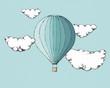 Leinwandbild Motiv Heißluftballon zwischen Wolken