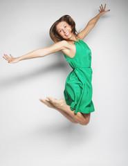 beautiful fairy flying girl in green dress