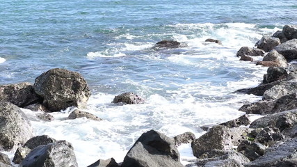 Sea waves hit the rock