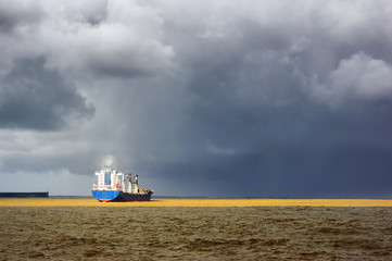 cargo ship with stormy weather