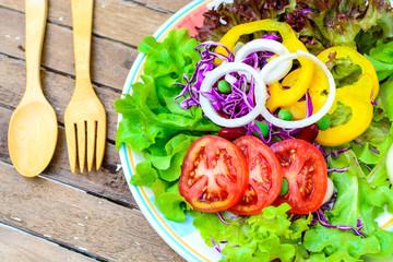 fresh salad on old wood table