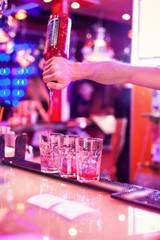 Barman making cocktail